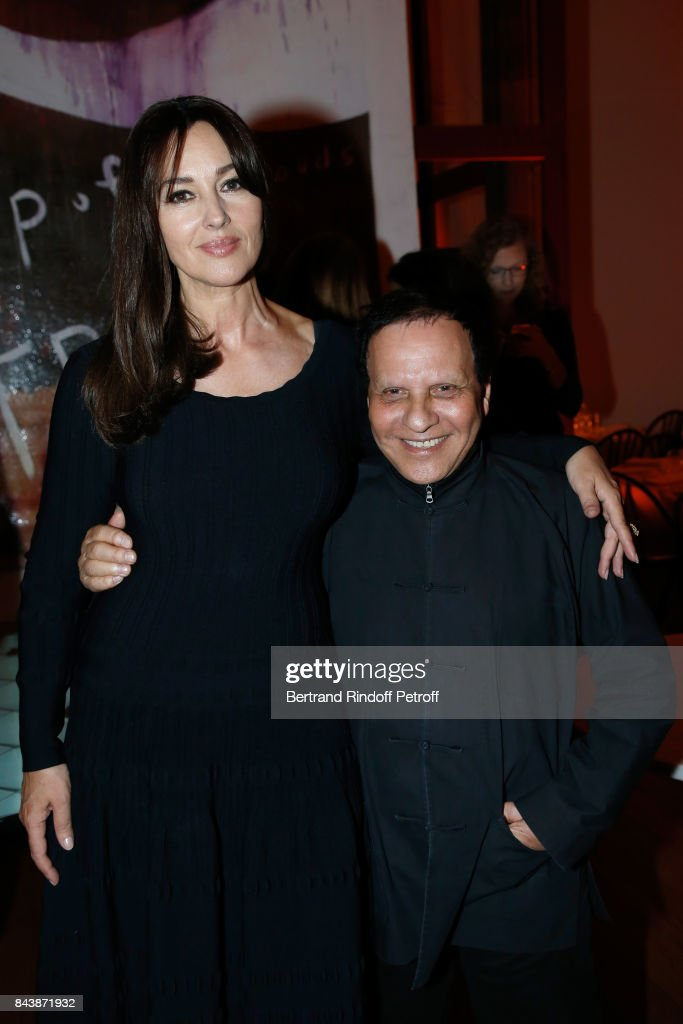 Actress Monica Bellucci, dressed in Azzedine Alaia, and stylist Azzedine Alaia attend the 'Richard Wentworth a la Maison Alaia' Exhibition Opening at Azzedine Alaia Gallery on September 7, 2017 in Paris, France.