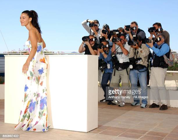 Actress Monica Bellucci poses for photographers during the photocall for 'Irreversible' at the Palis des Festival terrace during the 55th Cannes film...
