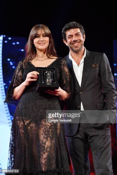 Actress Monica Bellucci receives Nastro D'Argento from Pierfrancesco Favino on stage during the Nastri D'Argento Awards Ceremony 2017 Awards Ceremony...