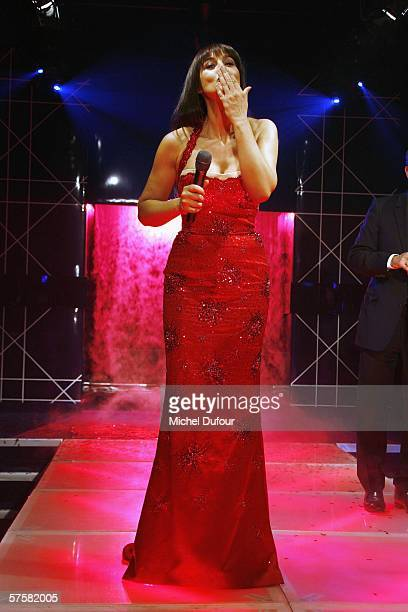 Actress Monica Bellucci takes to the catwalk during a Dior party launching the new lipstick Rouge Dior dedicated to famous designer Christian Dior at...
