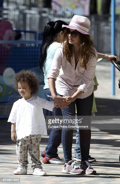Actress Monica Cruz and her daughter Antonella Cruz are seen at Madrid amusement park on March 30 2015 in Madrid Spain