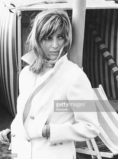 Actress Monica Vitti on a beach, arriving at the Lido for the presentation of her film 'Red Desert', at the Venice Film Festival, September 1964.