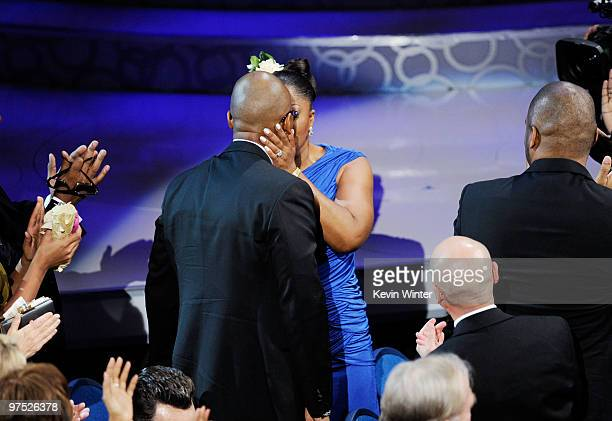 Actress Mo'Nique accepts Best Supporting Actress award for 'Precious Based on the Novel 'Push' by Sapphire' as she kisses her husband Sidney Hicks...
