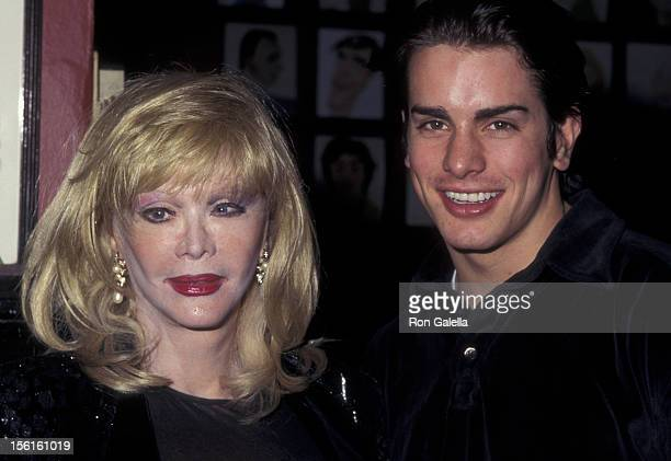 Actress Monique van Vooren and date attend the opening of 'The Sunshine Boys' on December 8 1997 at Sardi's Restaurant in New York City