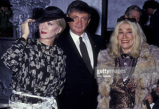 Actress Monique van Vooren Jacques Bellini and Sylvia Miles attend Andy Warhol Memorial Gala on April 1 1987 at the Diamond Horsehoe Restaurant in...