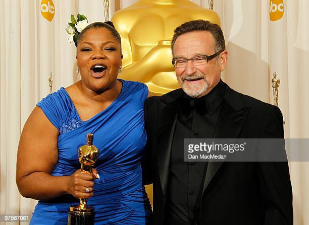 Actress Mo'Nique winner for Best Supporting Actress for Precious and actor Robin Williams pose in the press room at the 82nd Annual Academy Awards...