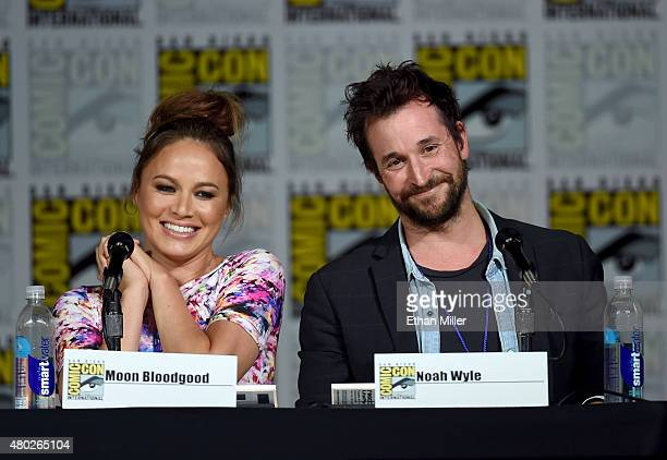 Actress Moon Bloodgood and actor Noah Wyle speak onstage at the Falling Skies The Farewell panel during ComicCon International 2015 at the San Diego...