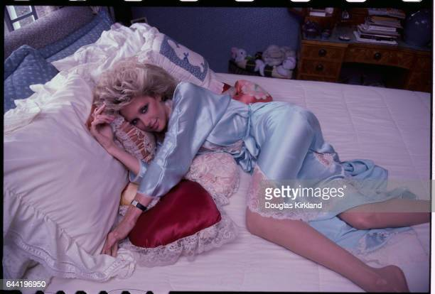 Actress Morgan Fairchild Lying on Bed Wearing Negligee
