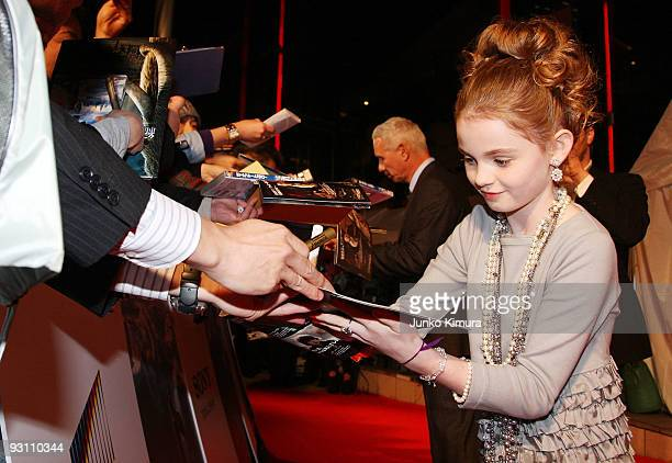 Actress Morgan Lily and Director Roland Emmerich sign autographs for their fans during the 2012 Japan Premiere at Roppongi Hills on November 17 2009...