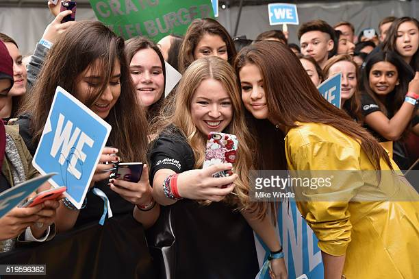 Actress multiplatinum recording artist and UNICEF Goodwill Ambassador Selena Gomez takes a selfie with fans at the WE Carpet at WE Day California...