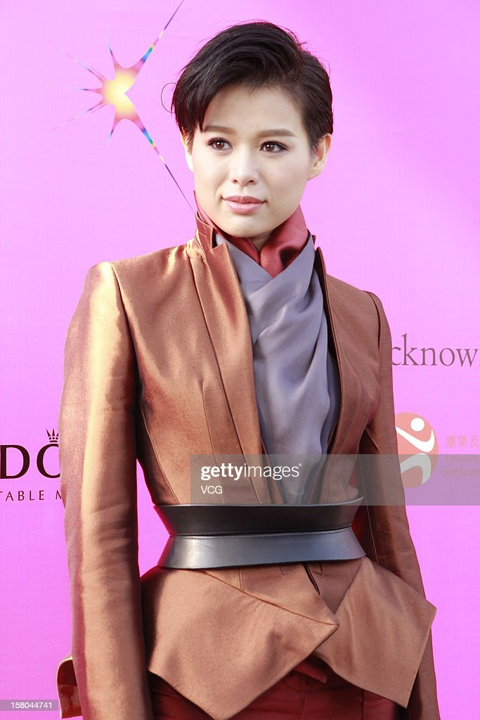 Actress Myolie Wu attends a catwalk show 'The World's Greatest Catwalk' at Victoria Harbour waterfront of Tsim Sha Tsui promenade on December 9, 2012 in Hong Kong, Hong Kong.