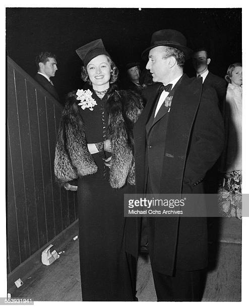 Actress Myrna Loy with husband producer Arthur Hornblow Jr attend an event in Los Angeles California