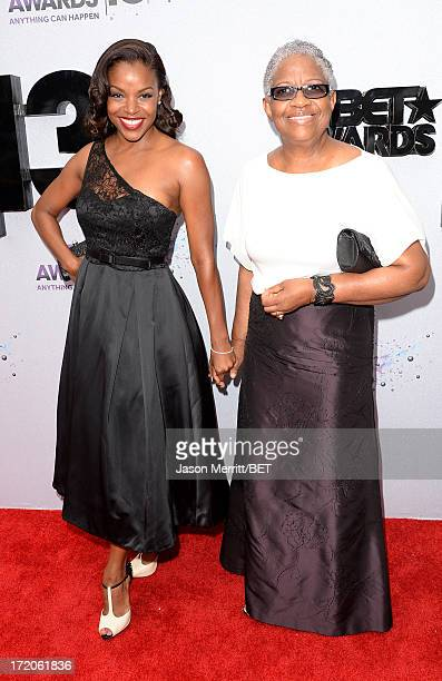 Actress Nadine Ellis and guest attend the Ford Red Carpet at the 2013 BET Awards at Nokia Theatre LA Live on June 30 2013 in Los Angeles California