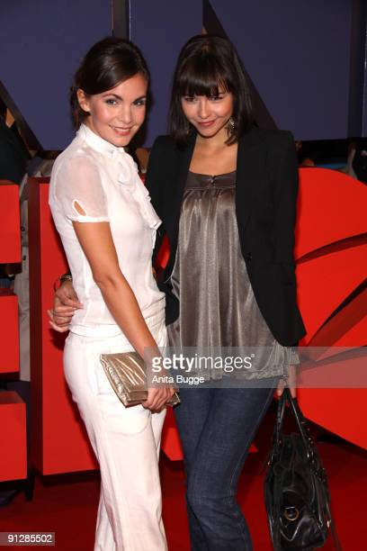 Actress Nadine Warmuth and friend attend the premiere of 'Maennerherzen' at the CineMaxx movie theater on September 29, 2009 in Berlin, Germany.