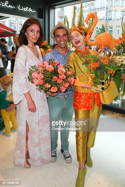 Actress Nadine Warmuth Kian ShamsDolatabadi and Britt Kanja attend the 'Kians Garden Flower Shop' Opening Event at Kantstrasse on July 11 2017 in...