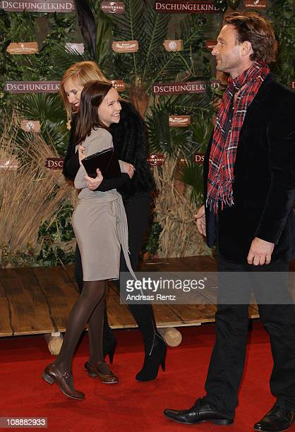 Actress Nadja Uhl hugs young actress Stella Kunkat as actor Thomas Kretschmann smiles at the 'Dschungelkind' Premiere at CineStar on February 7 2011...