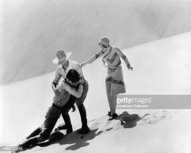 Actress Nancy Carroll John Boles and Jack Holt in a scene from the movie The Water Hole