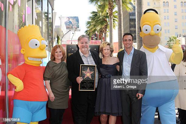 Actress Nancy Cartwright creator Matt Groening actress Yeardley Smith and actor Hank Azaria at the Matt Groening Hollywood Walk Of Fame ceremony on...