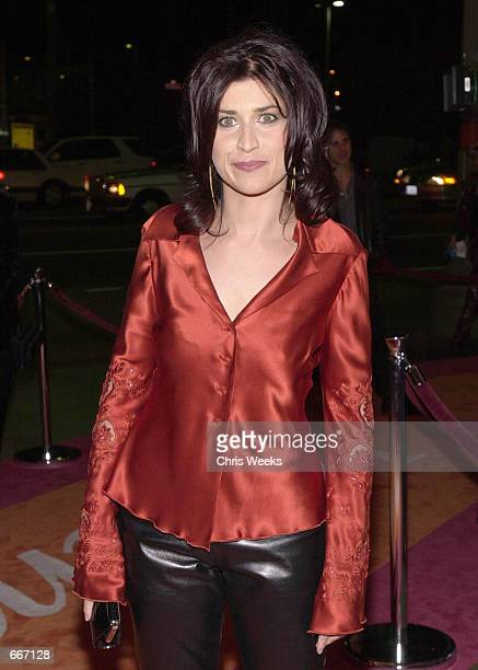 """Actress Nancy McKeon poses for photographers while arriving at the Lifetime Channel's """"Women Rock: Girls with Guitars"""" October 12, 2000 at the..."""