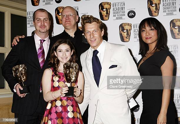 Actress Naoko Mori presents cast and crew of 'Lazy Town' including actors Julianna Rose Mauriello and Magnus Scheving with the International award at...