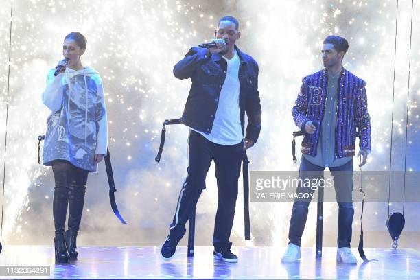 Actress Naomi Scott Will Smith and Mena Massoud appear on stage during the 32nd Annual Nickelodeon Kids' Choice Awards at the USC Galen Center on...