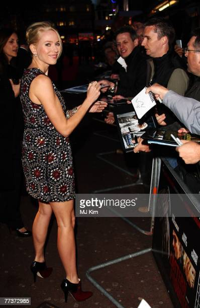 Actress Naomi Watts signs autographs as she arrives at the BFI 51st London Film Festival 'Eastern Promises' premiere at the The Odeon Cinema,...