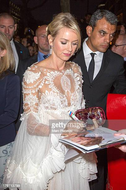 Actress Naomi Watts signs autographs as she attends the 'Diana' Paris premiere at Cinema UGC Normandie on September 6 2013 in Paris France