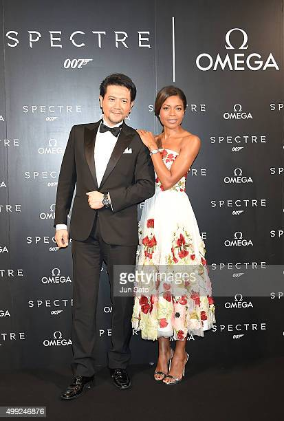 Actress Naomie Harris and actor Tetsuya Besso attend the photocall for the OMEGA 'Spectre' on November 30 2015 in Tokyo Japan