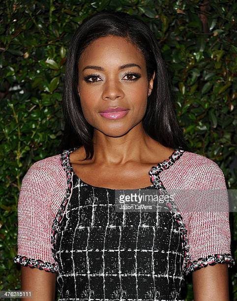Actress Naomie Harris attends the Chanel and Charles Finch preOscar dinner at Madeo Restaurant on March 1 2014 in Los Angeles California
