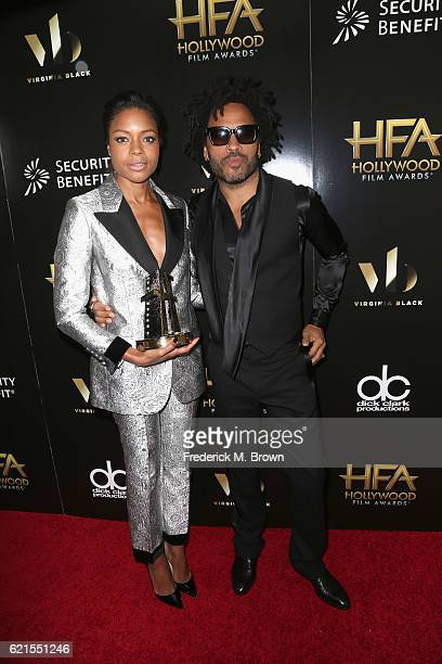 Actress Naomie Harris recipient of the 'Hollywood Breakout Actress Award' for 'Moonlight' and resenter Lenny Kravitz poses in the press room at the...