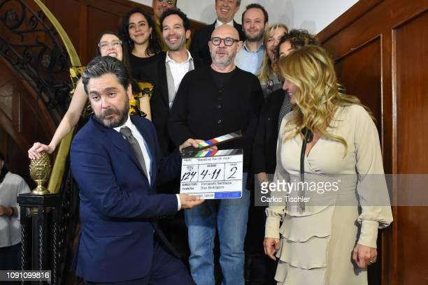 actress Naomy Romo Director Fernando Sariñana Actor Martin Altomaro and Andrea Legarreta pose for photos with a clapperboard during the filming of...