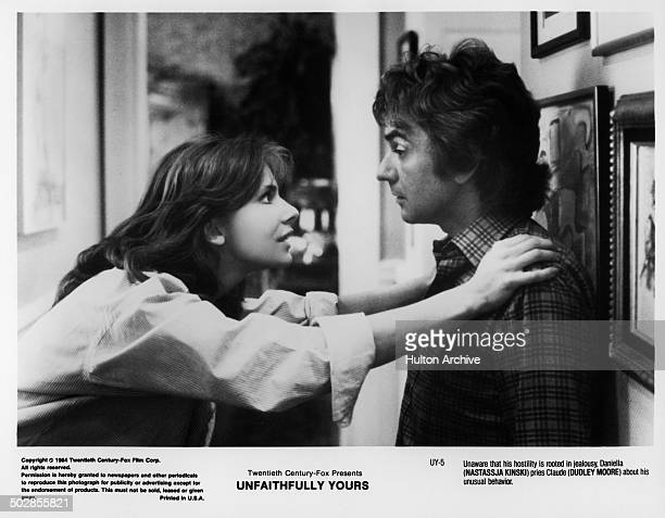 Actress Nastassja Kinski and actor Dudley Moore talk in a scene during the 20th Century Fox movie Unfaithfully Yours circa 1984