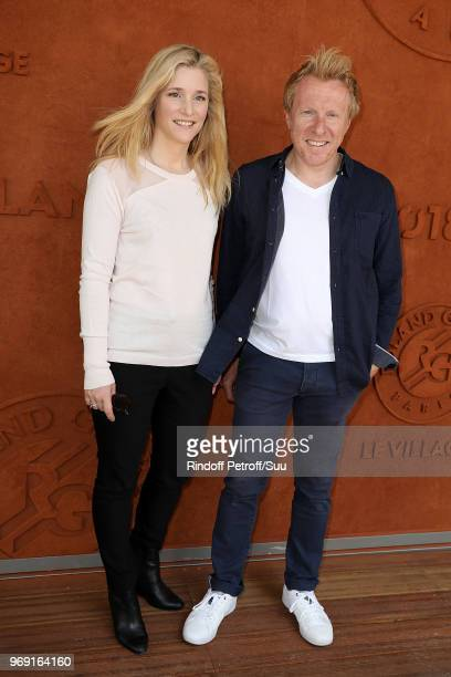 Actress Natacha Regnier and her companion journalit Jerome Pitorin attend the 2018 French Open Day Twelve at Roland Garros on June 7 2018 in Paris...