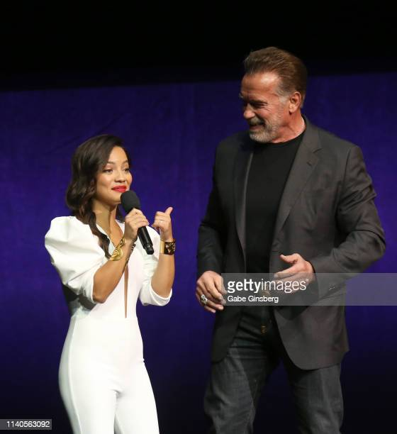 Actress Natalia Reyes and actor Arnold Schwarzenegger speak during Paramount Pictures exclusive presentation during CinemaCon at The Colosseum at...