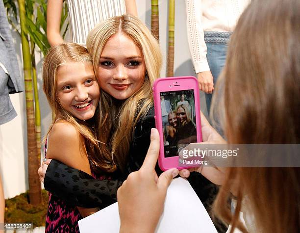 Actress Natalie Alyn Lind takes a photo with a guest at Veronica Beard Presentation Spring 2016 during New York Fashion Week on September 15 2015 in...