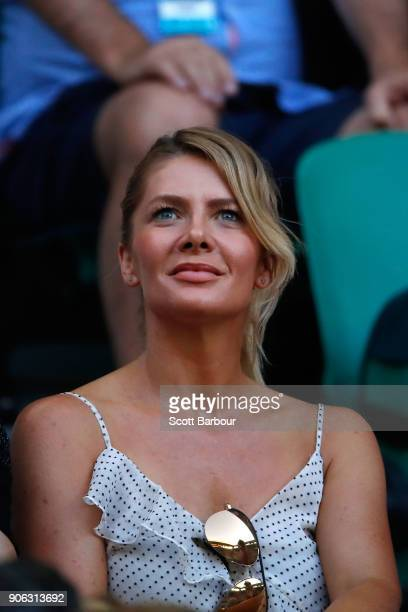 Actress Natalie Bassingthwaighte and her husband Cameron McGlinchey watch Ashleigh Barty of Australia and Camila Giorgi of Italy in their second...