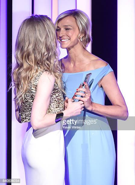 Actress Natalie Dormer accepts the Women in Film Max Mara Face of the Future Award from Max Mara Brand Ambassador Nicola Maramotti onstage at the...