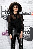 london england actress natalie emmanuel poses
