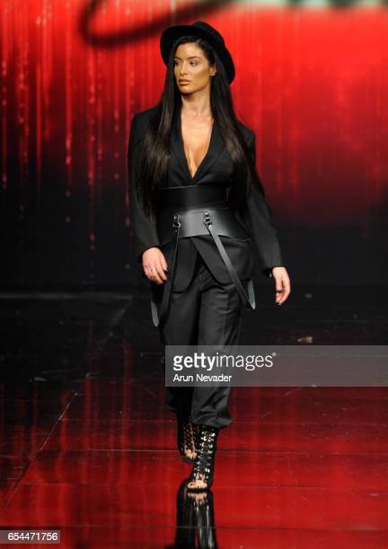 Actress Natalie Eva Marie walks the runway wearing Stello at Art Hearts Fashion LAFW Fall/Winter 2017 Day 3 at The Beverly Hilton Hotel on March 16...