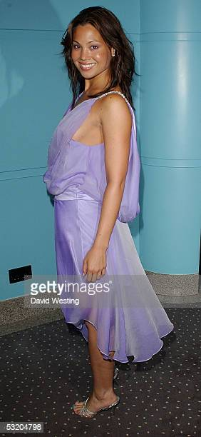 Actress Natalie Mendoza arrives at the UK film premiere for The Descent at Vue West End on July 6 2005 in London England