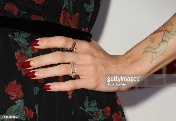 Actress Natalie Morales jewelry and nail detail attends the premiere of Free Fire at ArcLight Hollywood on April 13 2017 in Hollywood California