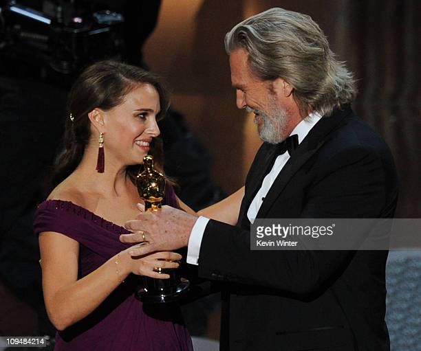 Actress Natalie Portman accepts the award for Best Performance by an Actress in a Leading Role for the 'Black Swan' from presenter Jeff Bridges...
