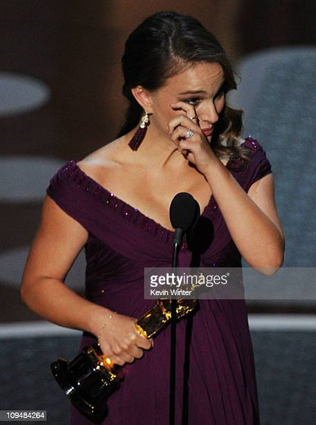 Actress Natalie Portman accepts the award for Best Performance by an Actress in a Leading Role for the 'Black Swan' onstage during the 83rd Annual...