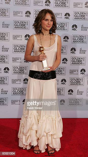Actress Natalie Portman poses with her award for 'Actress in a Supporting Role' to the 62nd Annual Golden Globe Awards at the Beverly Hilton Hotel...