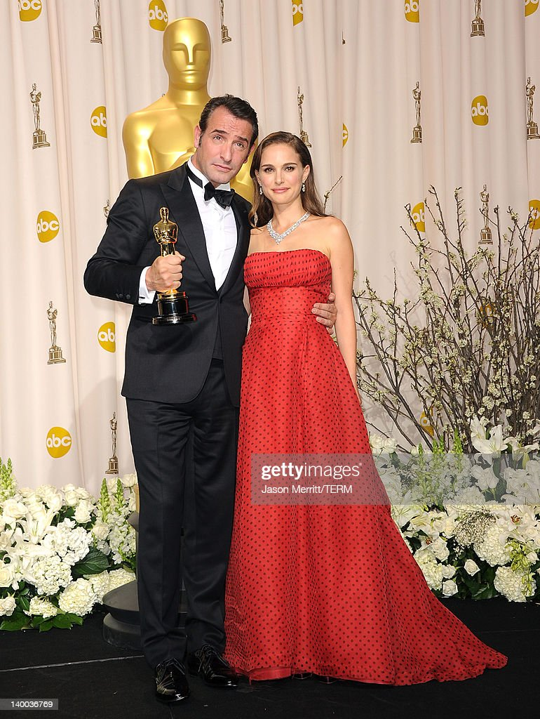 Actress Natalie Portman (R) poses with Jean Dujardin (L), winner of the Best Actor Award for 'The Artist,' in the press room at the 84th Annual Academy Awards held at the Hollywood & Highland Center on February 26, 2012 in Hollywood, California.