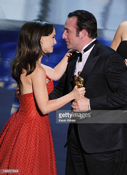 Actress Natalie Portman presents actor Jean Dujardin the Best Actor Award for The Artist onstage during the 84th Annual Academy Awards held at the...