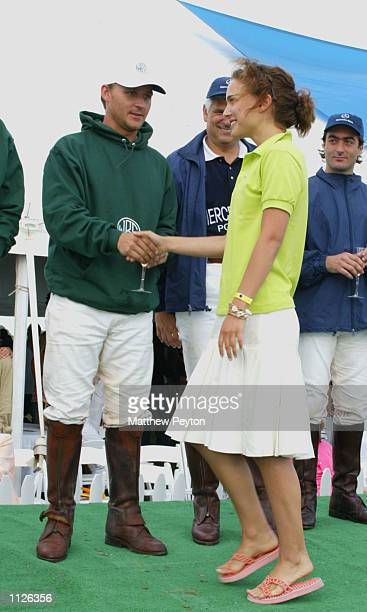 Actress Natalie Portman presents the winning team the cup at the 8th annual MercedesBenz Polo Challenge July 13 2002 in Bridgehampton New York