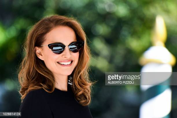 TOPSHOT Actress Natalie Portman smiles as she arrives by boat at the pier of the Excelsior Hotel on September 4 2018 during the 75th Venice Film...
