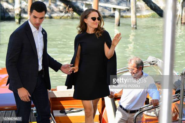 Actress Natalie Portman waves as she arrives by boat at the pier of the festival's palace on September 4 2018 during the 75th Venice Film Festival at...