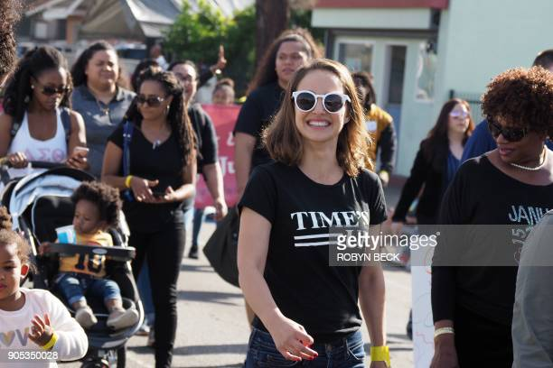Actress Natalie Portman wearing a Time's Up Tshirt marches in the 33rd annual Kingdom Day Parade honoring Dr Martin Luther King Jr January 15 2018 in...